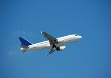 Airbus A-319 in flight. Airbus A-319 passenger jet climbing after take off Stock Image