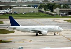Airbus A-319 jet liner. Airbus A-319 passenger liner delayed at airport Stock Photography