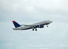 Airbus A-319 passenjer jet in flight. Airbus A-319 climbing after takeoff royalty free stock photo