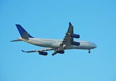 Airbus A-340 jumbo jet liner. Airbus jumbo jet approaching airport for landing Stock Photo