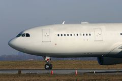 Airbus A340. An Airbus A340 is lining up on the runway Royalty Free Stock Photo