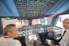 Airbus A350 flight simulator at the Singapore Airshow 2014. A mock up flight deck and simulator of the new Airbus A350-900 XWB on display at the Singapore royalty free stock photos