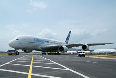 Airbus A380. Front view of Airbus A380 being towed during the Singapore Airshow, February 2008. Very wide perspective Royalty Free Stock Image