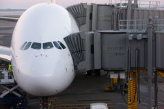 Airbus A380 airliner docked for boarding. Stock Photos