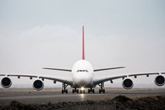 Airbus A380 Airliner in front view. Airbis A380 airliner on runway in front view Stock Image