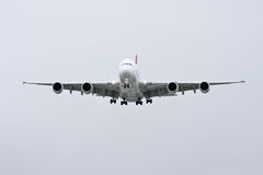 Airbus A380 in flight - front view. Front view of Airbus A380 airliner approaching landing Royalty Free Stock Image