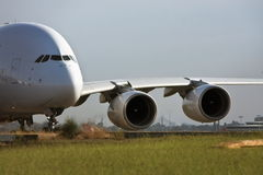 Airbus A380 jet airliner on runway. Airbus A380 jet airliner taxiing on the runway Stock Photos