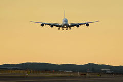Airbus a380 about to touchdown - front view. Airbus A380 airliner about to land on runway - front view Royalty Free Stock Image