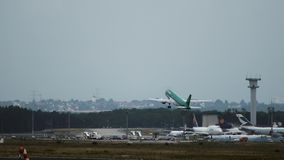Airbus A320 of Aer Lingus airlines takeoff. FRANKFURT AM MAIN, GERMANY - JULY 19, 2017: Rear view of Airbus A320 of Aer Lingus airlines take off at Frankfurt am stock photography