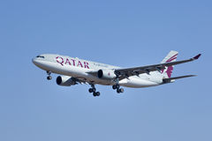Airbus A330-202, A7-AFL from Qatar Airways landing in Beijing, China Royalty Free Stock Photo