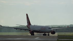 Airbus A330 of Air Berlin Airways arrived in airport. DUSSELDORF, GERMANY - JULY 22, 2017: Airbus A330 of Air Berlin airlines is taxiing from runway after landed stock footage