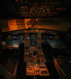 Airbus A319 aircraft illuminated interior without pilots at night Stock Photo