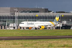 Airbus A 321 from airline Condor drives on airport to the runway. LANGENHAGEN / GERMANY - OCTOBER 28, 2017: Airbus A 321 from airline Condor drives on airport to Royalty Free Stock Photo