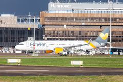 Airbus A 321 from airline Condor drives on airport to the runway. LANGENHAGEN / GERMANY - OCTOBER 28, 2017: Airbus A 321 from airline Condor drives on airport to Stock Photography