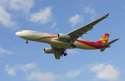 The Airbus A330-343 airline Hainan Airlines before landing in Pulkovo airport. SAINT PETERSBURG, RUSSIA - JULY 24, 2015: The Airbus A330-343 airline Hainan Royalty Free Stock Image