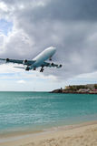 Airbus Airplane Landing over the Sea Stock Photo