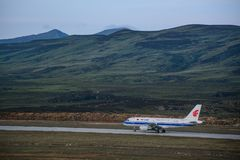 An Airbus airplane on mountainous runway stock images