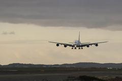 Airbus A380 approaching landing on grey day Stock Photography
