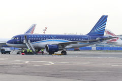 Airbus A320 Azerbaijan Airlines on the apron of Domodedovo Airport. MOSCOW, RUSSIA - SEPTEMBER 26, 2014:  Airbus A320 Azerbaijan Airlines on the apron of Royalty Free Stock Photography