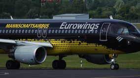 Airbus A320 Borussia Dortmund Livery taxiing. Dusseldorf, Germany - July 22, 2017: Close-up of Airbus A320-214 D-AIZR of Eurowings Airlines Borussia Dortmund stock video footage