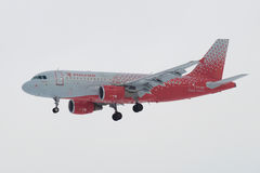 Airbus A319-112 `Chelyabinsk` VP-BIS of airline `Rossiya Airline` in cloudy sky before landing in Pulkovo airport Stock Photos
