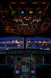 Airbus cockpit. With airport scene at night royalty free stock photos