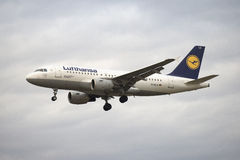 The Airbus A319-100 (D-AILE) Lufthansa flies on the background of a gloomy sky Stock Photos