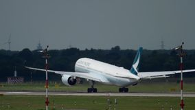 Airbus A350 departure. Dusseldorf, Germany - July 22, 2017: Cathay Pacific Airbus A350 B-LRQ accelerate and rotate. Dusseldorf Airport, Germany stock video