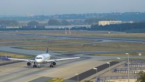 Airbus A320 drives on taxiway at Frankfurt Airport. FRANKFURT AM MAIN, GERMANY - JULY 16, 2017: Lufthansa Airbus A320 drives at the taxiway after landed in stock footage
