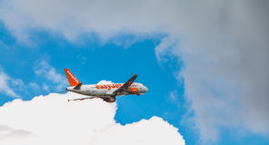 Airbus A320 of EasyJet registered HB-JXC flying above Nantes Atlantique Airport stock image
