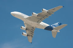 Airbus A380. Farnborough, UK - July 18, 2014: Closeup of an Airbus A380 super-jumbo jet airliner in the skies above Farnborough, Hampshire, UK Royalty Free Stock Image