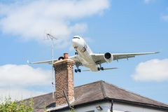 Airbus A350. Farnborough, UK - July 14, 2014: Qatar Airways Airbus A350 on landing approach over rooftops to participate at the Farnborough Airshow,  UK Stock Photos