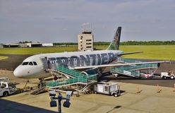An Airbus A319 from Frontier Airlines. TRENTON, NJ -24 MAY 2015- An Airbus A319 from Frontier Airlines (F9) with a deer on the tail at the Trenton-Mercer Airport Royalty Free Stock Images