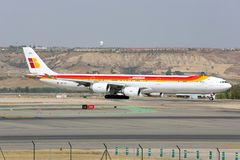 Airbus A340-642 of Iberia airline taxiing at Madrid Barajas Adolfo Suarez airport. Madrid, Spain - August 12, 2015: Airbus A340-642 of Iberia airline taxiing at Royalty Free Stock Photography