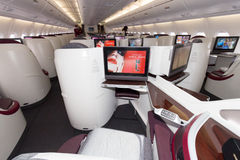 Airbus A380 interior. PARIS - JUN 18, 2015: Layout of the Business Class of a Qatar Airways Airbus A380. The A380 is the largest passenger airliner in the world Royalty Free Stock Photo
