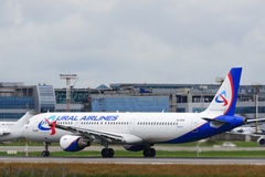 Airbus A321 jet aircraft. DOMODEDOVO, RUSSIA - JULY 20: Aircraft operated by Ural Airlines, readiy to take off at Moscow airport in Domodedovo on July 20, 2013 Royalty Free Stock Photography
