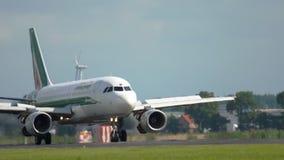 Airbus A319 landing. AMSTERDAM, THE NETHERLANDS - JULY 26, 2017: Alitalia Airbus A319 braking after landing landing on runway 18R Polderbaan. Shiphol Airport stock video
