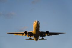 Airbus Landing at Dusk. The front of an Airbus A310 nicely illuminated from the side by the setting sun royalty free stock photography
