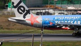 Airbus A320 landing. PHUKET, THAILAND - NOVEMBER 30, 2018: JetStar Airbus 320 9V-JSH landing and braking, International Phuket Airport stock footage