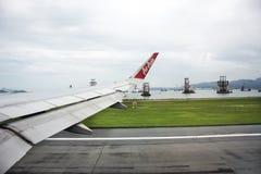 Airbus landing on runway at Hong Kong International Airport in HongKong China stock images