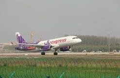 A airbus 320 landing on the runway. A Hongkong express airbus 320 landing at Zhengzhou Airport Stock Photo