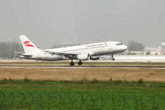 A airbus 320 landing on the runway Royalty Free Stock Image