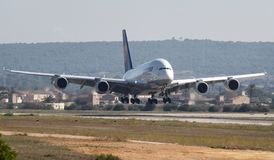 Airbus A380 landing in Palma de mallorca airport. Airbus A380 lands in palma de mallorca airport. The Airbus A380 is a double-deck, wide-body, four-engine jet royalty free stock photo