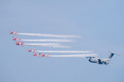 Airbus A400M escorted by fighter squad Royalty Free Stock Photos