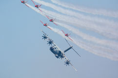 Airbus A400M escorted by fighter squad Stock Photography