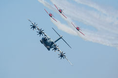 Airbus A400M escorted by fighter squad Stock Images
