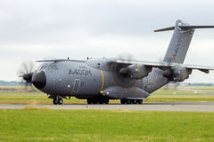 Airbus A400M military transport airplane. PARIS - LE BOURGET - JUN 18, 2015: New Airbus A400M military transport plane taxiing before take-off at the 51st Royalty Free Stock Photo