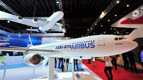 Airbus A330-200 and A380 models on display at the Airbus booth at Singapore Airshow Royalty Free Stock Photo