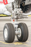 Airbus A350 nose wheel undercarriage. Farnborough, UK - July 15, 2016: Closeup section of an Airbus A350 nose wheel undercarriage on the taxiway at an aviation Stock Photo