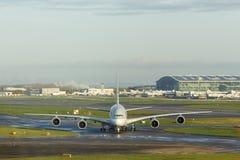 Airbus A380 Passenger Aircraft Taxiing at Airport. Front on shot of a passenger aircraft taxiing at an airport. Taken at London Heathrow Royalty Free Stock Photo